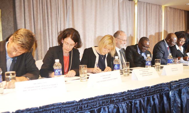 ZESCO managing director Cyprian Chitundu (second from right), Energy Deputy Minister Charles Zulu (third from right), Swedish Embassy first secretary Lars Karlsson, Nordea Bank vice president and senior relationship manager Christina Rydegran, Nordea Bank export and project finance director Marie Vetland and Standard Bank of South Africa head of Export Credit Agency and cross-border finance Greg Fyfe. This was during the signing of US $163 million loan agreement between ZESCO and the two banks in Lusaka