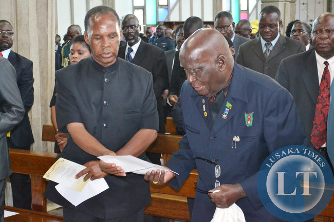 First Republican President Kenneth Kaunda and National assembly Deputy Speaker Mkhondo Lungu sing a hymn at Cathedral of the Holy Cross in Lusaka