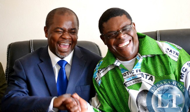 Copperbelt Province Patriotic Front Chairman Stardy Mwale (left) shares a light moment with his Lusaka Province counterpart Geoffrey Chumbwe