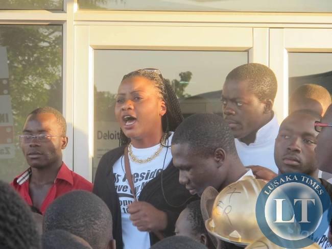 Action Aid Zambia Country Director Pamela Chisanga addressing protestors