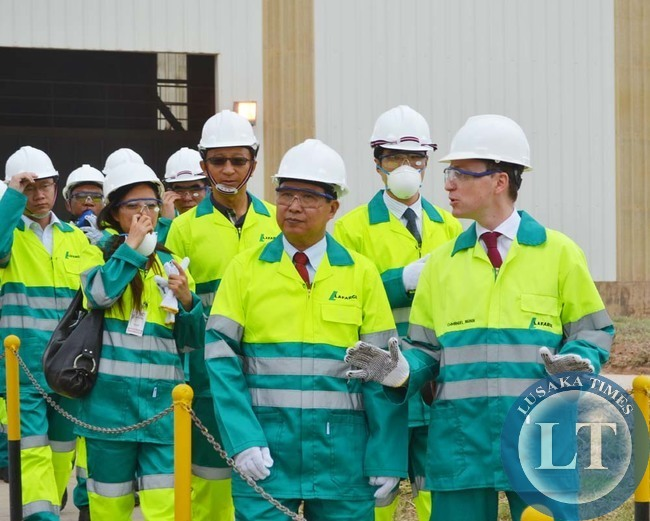 LAFARGE Zambia managing director Emmanuel Rigaux (right) explaining a point to Chinese Ambassador to Zambia Zhou Yuxiao (left) during a tour of the cement plant in Chilanga