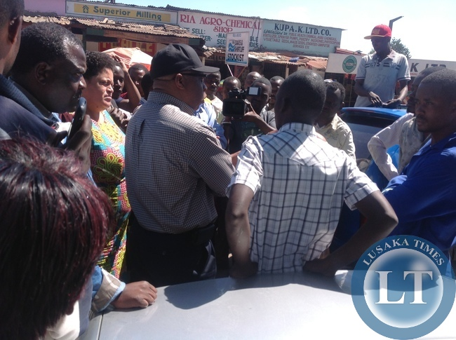 Nevers Mumba Listening to Tax Drivers at Chisokone Market in Kitwe