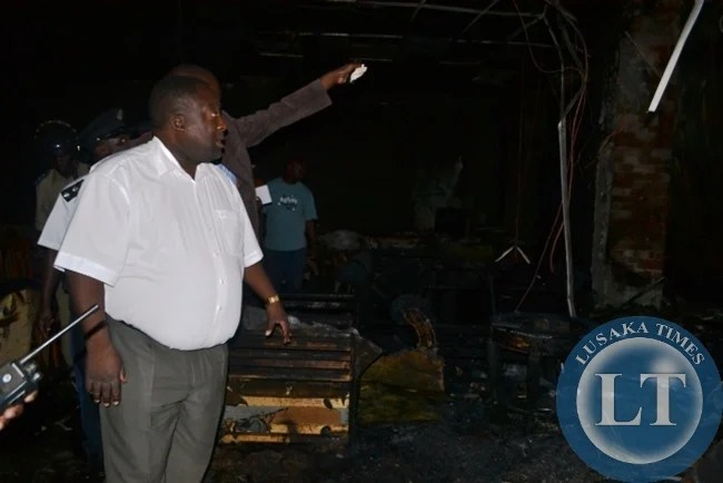 COPPERBELT Minister Mwenya Musenge inspecting extent of fire damage at Carnival Furnishers in Kitwe