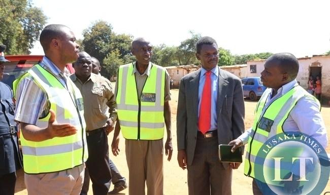 ,Lusaka Province Minister Phillip Kosamu talks to shibuyunji DC Phanwell Mweemba during the tour of roads in shibuyunji district