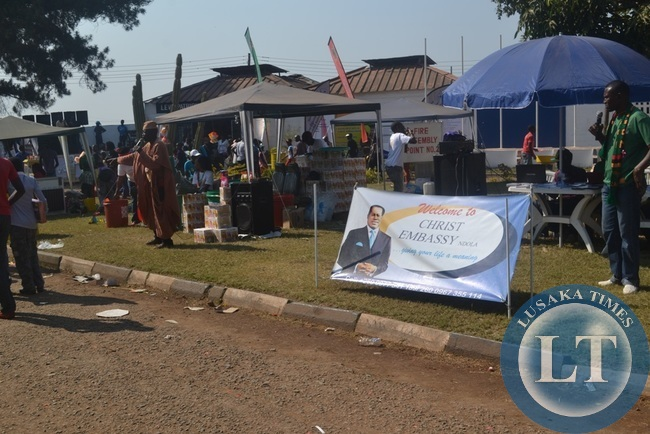 SCRAMBLE for customers. Two exhibitors at the ZITF battle to attract customers using microphones on
