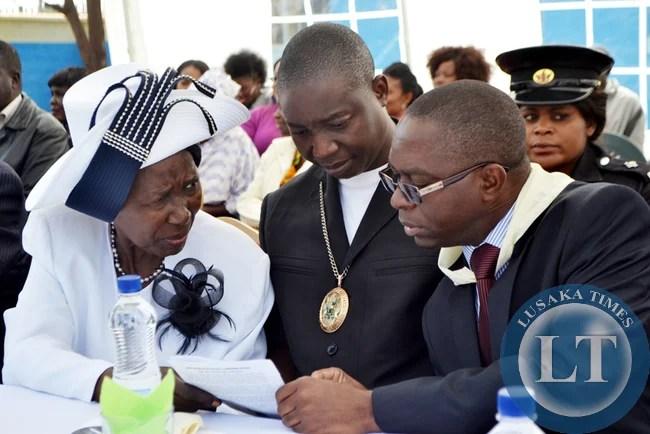 GENDER and Child Development Minister Inonge Wina (left), Lusaka deputy Mayor Potipher Tembo (centre) and Arthur Wina Primary School Parents Teachers Association chairperson Damaseke Chibale.