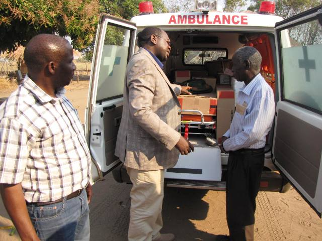 DR Chilufya (middle) explain how basic support systems operates in an ambulance to Chief Nabwala (right) during the handover of the facility to Nabwalya health center. Looking on is area member of parliament Mwimba Malama