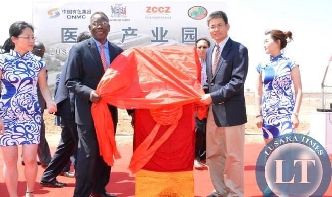Minister of Health Joseph Kasonde and Chinese Ambassador to Zambia Yang Yaoming unveiling the ribbon of Medical Park at multi facility Economic Zone