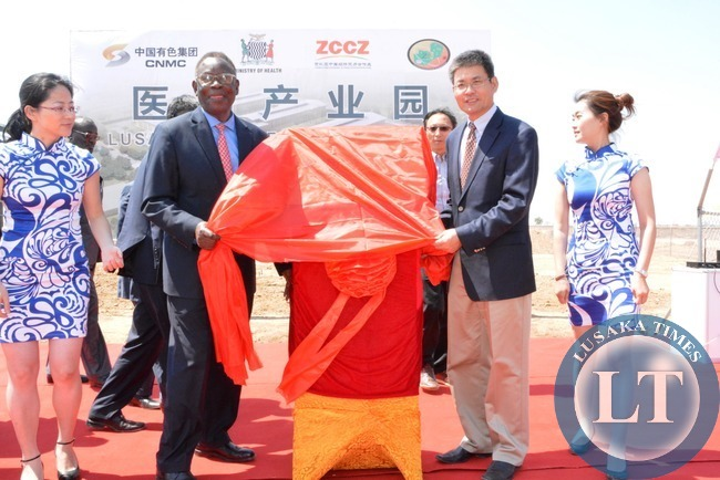 Minister of Health Joseph Kasonde and Chinese Ambassador to Zambia Yang Yaoming unveiling the ribbon of Medical Park at multi facility Economic Zone