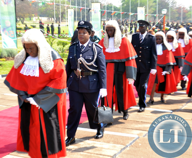 Acting Chief Justice Lombe Chibesakunda (left) leads members of the judiciary on arrival at the official opening of parliament