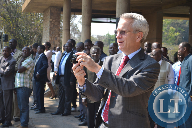 British High Commissioner James Thornton shoots photographs at the official opening of Parliament.