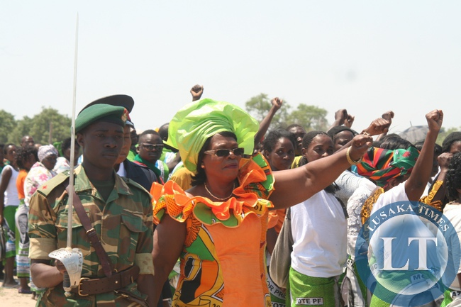 Guest of Honuor, Chiefs Minister Prof. Nkandu Luo (c) inspecting the guard of honour during the Golden Jubilee Independence Day Celebrations at Mongu Stadium in Mongu District of Western Province, October 24, 2014.