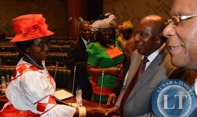 Gender Minister Inonge Wina congratulates Finance Minister Alexander Chikwanda shortly after Finance Minister delivered the 2015 budget