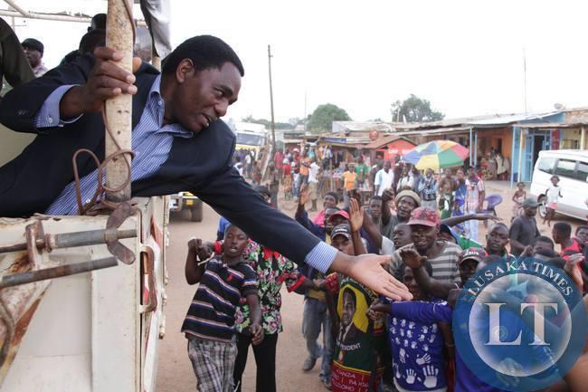UPND president Hakainde Hichilema greets Solwezi residents