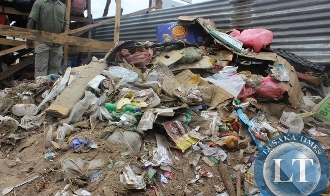 A HEAP of uncollected garbage behind a shopping mall in Choma