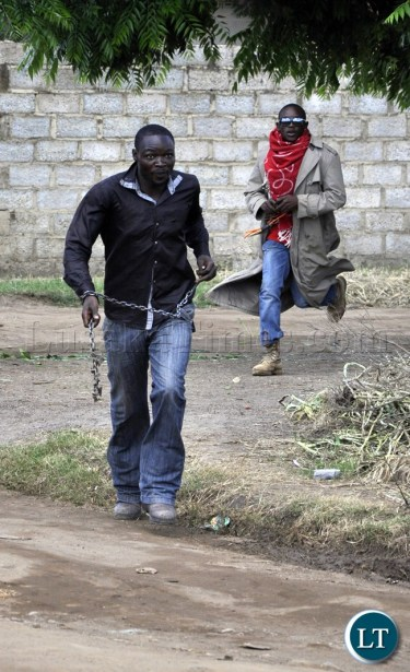 File picture:PF-militia...a-PF-youth-wielding a dangerous-weapon goes for UPND-cadres during the Kabwata violence