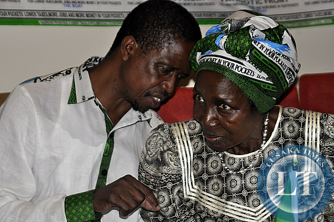 Edgar Lungu confers with Inonge Wina during the press conference where Rupiah Banda announced his support for Lungu