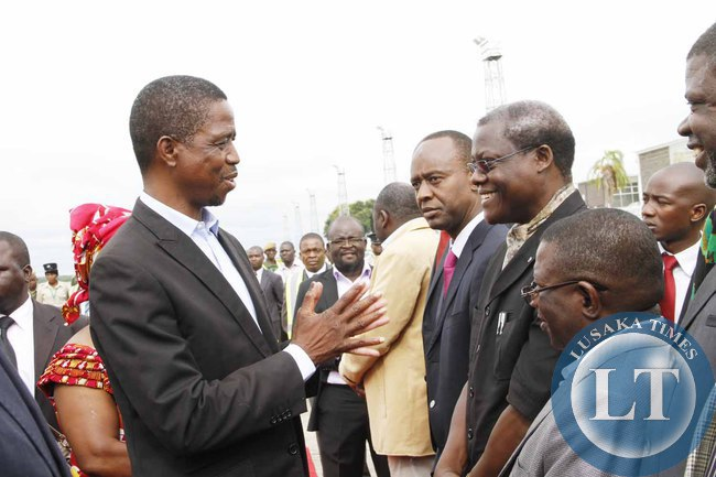 President Edgar Lungu greets his  Special Assistant for  Political Affairs Kaiza Zulu on arrival at Kenneth Kaunda International Airport shortly before departure to Addis Ababa, Ethiopia for the African Union Summit on January 29,2015 -Picture by THOMAS NSAMA