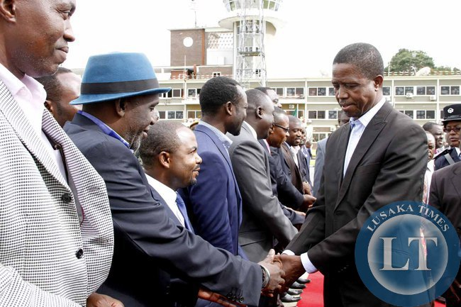 President Edgar Lungu greets Rabson Soko  on arrival at Kenneth Kaunda International Airport shortly before departure to Addis Ababa, Ethiopia for the African Union Summit on January 29,2015 -Picture by THOMAS NSAMA