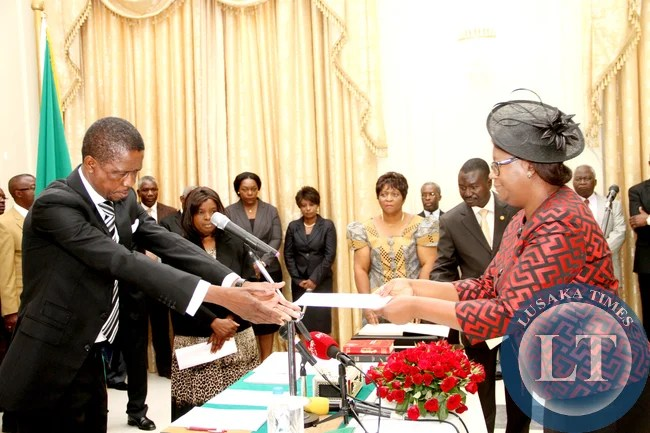 President Edgar Chagwa Lungu  receiving an affidavit of  Oath from  Zambia's High Commissioner to Namibia Sylvia Chalikosa (r)   during the Swearing-in-Ceremony at State House in Lusaka on January 28,2015 -Picture by THOMAS NSAMA