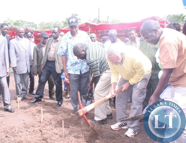 Acting President Guy Scott (digging ( with a pick ) and Patriotic Front secretary general Davies Chama (second left) and Health deputy minister Dr Chitalu CAhilufya (r ) during a ground breaking ceremony for the construction of Ikelenge district hospital in Ikelenge on Friday as Local government minister Emmanuel Chenda (l) looks on