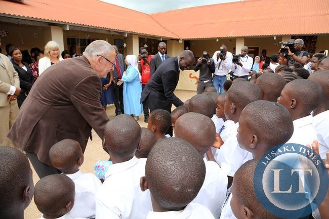 Kenya's Deputy President William Ruto with Guy Scott interacting with children at the orphanage