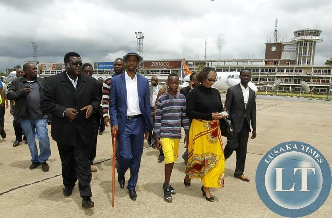 Patriotic Front (PF) President,Hon.Edgar Chagwa Lungu (second right) being escorted by his Campaign Manager Willie Nsanda (left) and Mumbi Phiri (right) before leaving Kenneth Kaunda International Airport on his way to Luapula Province for campaigns on Saturday,January 10,2015.PICTURE BY SALIM HENRY/SHENPA