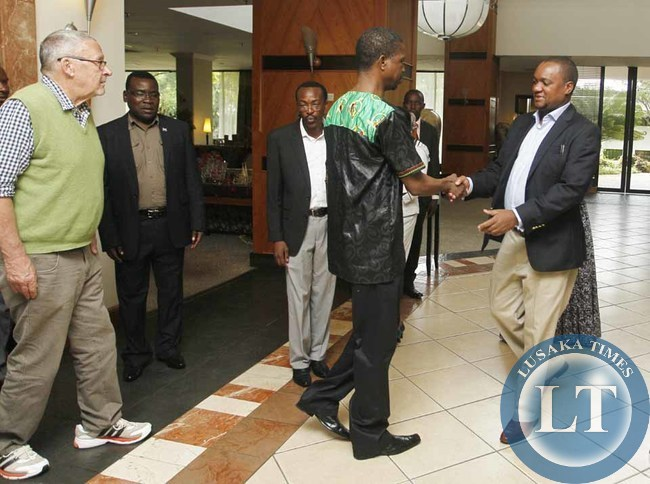 Acting President,Dr. Guy Scott (left) watches as  Patriotic Front (PF) President,Hon. Edgar Chagwa Lungu (centre) greets Matero Member o Patrliament at Pamodzi Hotel l in Lusaka,Zambia on Thursday,January 1,2015.PICTURE BY SALIM HENRY/SHENPA