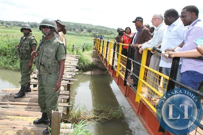 Acting President Dr Guy Scott checks on  Kantolomba Bridge built  by PF government on the Kafubu river in Ndola's Twapia township. With him are Sports minister Chishimba Kambwili,Local government minister Emmanuel Chenda and Mufurila District Commissioner Chanda Kabw