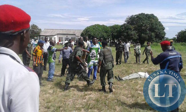 Police restrain attacker after he bludgeoned a UPND cadre