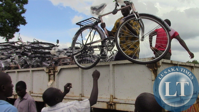 A man offloading a bicycle from a truck on saturday when  Kasenengwa MP Victoria Kalima handed over bicycles to  village head-person