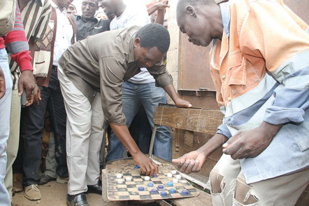 HH playing a game of Draughts