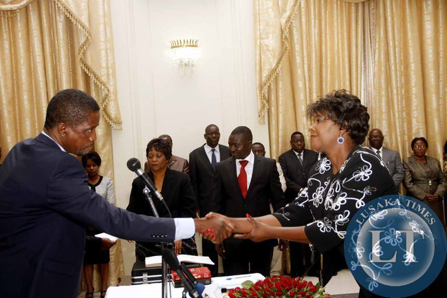 President Edgar Lungu congratulates newly appointed Commerce minister Margaret Mwanakatwe during the Swearing-In-Ceremony at State House on February 3,2015 -Picture by THOMAS NSAMA