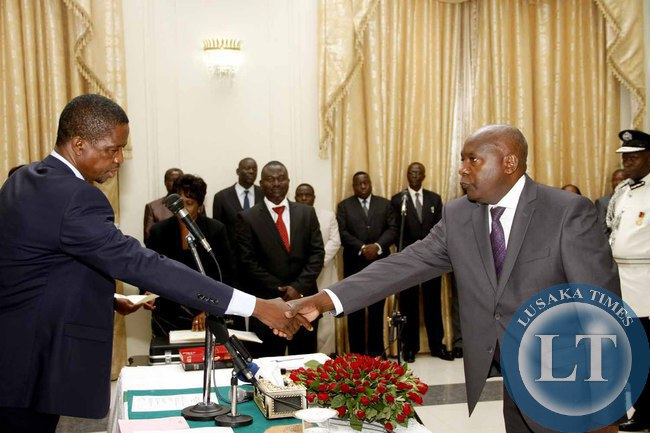President Edgar Lungu congratulates Newly appointed Luapula Province Permanent Secretary Boniface Chimbwali   during the Swearing-In-Ceremony State House on February 3,2015 -Picture by THOMAS NSAMA