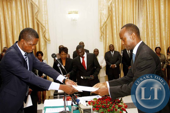 President Edgar Lungu receives an affidavit of Oath from State House Deputy minister Mulenga Sata during the Swearing-In-Ceremony at State House on February 3,2015 -Picture by THOMAS NSAMA
