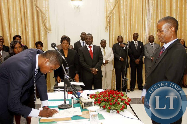 President Edgar Lungu with  Chiefs and Traditional affairs  minister Dr Joseph Katema during the Swearing-In-Ceremony at State House on February 3,2015 -Picture by THOMAS NSAMA
