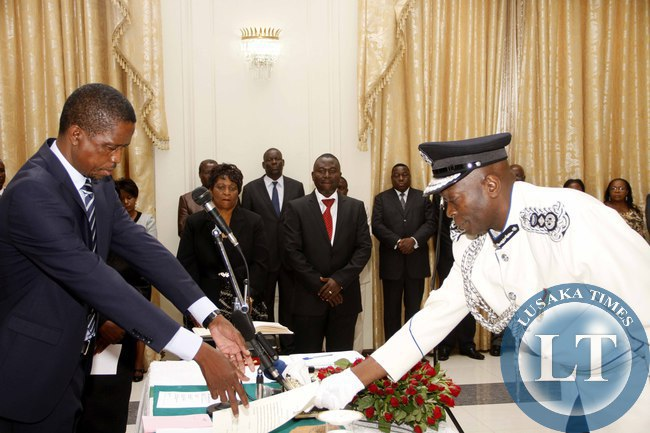President Edgar Lungu receives an affidavit of Oath from Deputy Inspector General of Police Kakoma Kanganja during the swearing -in-Ceremony at State House on February  3,2015 -Picture by THOMAS NSAMA