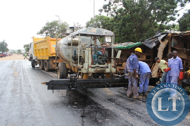 A Bituminous Road in the Making; BSBK contractors working on one of the urban roads in Monze. Government through the Ministry of Local Government and Housing engaged BSBK to upgrade 15 kilometers of townsahip roads to bituminous standard at the cost of about K120,000