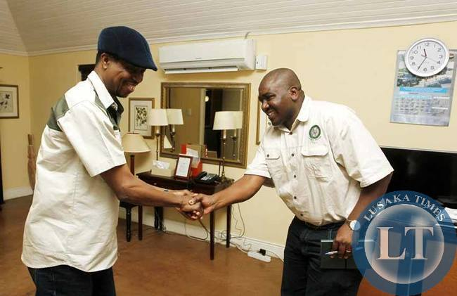 President Edgar Chagwa Lungu (left) welcomes Zambia Wildlife Authority (ZAWA) Acting Director General Kampamba Kombe at Chichele Presidential Lodge in Mfuwe on Saturday,February 7,2015. PICTURE BY SALIM HENRY/STATE HOUSE