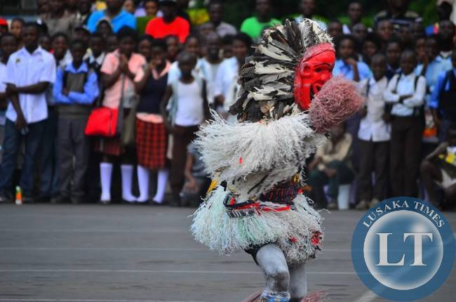 A member of the Makishi Dance Troupe from Western Zambia mesmerises the crowd at the street carnival during LICAF2015