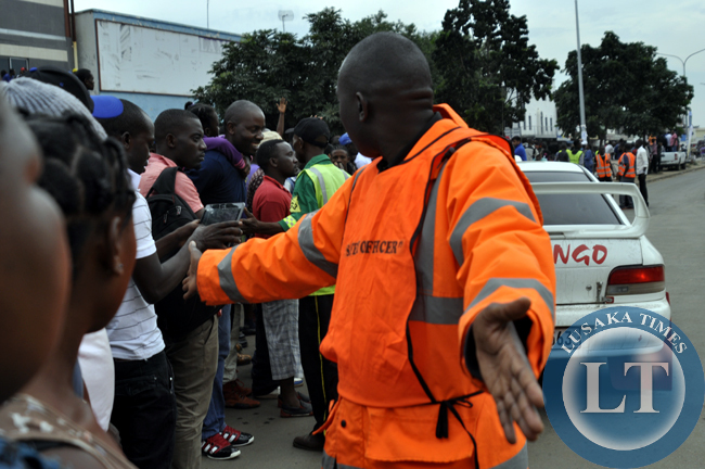 An official conducts crowd control at the rally motor event