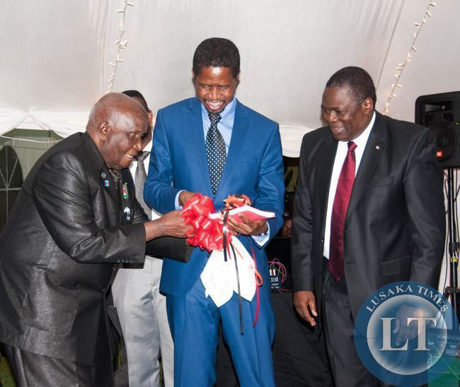 Dr Kenneth Kaunda and President Edgar Lungu admire the reprint of Dr Kaunda's book Zambia Shall Be Free, looking on is  Kagem chairman William B Nyirenda