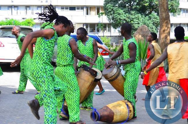 The members of the Zimbabwe Dance Troupe drumming up during the street carnival in Livingstone