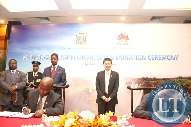 President Edgar Lungu and Huawei Senior Vice-President Dafeng Li witnessing the signing ceremony between Huawei Zambia managing director Fan Wen and Ministry of Energy representative Victor Mudenda at Shenzhen Wuzhou Guest House on April 1,2015 -Picture by THOMAS NSAMA