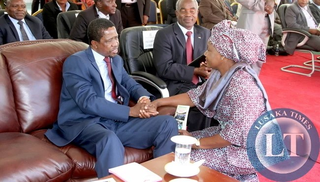 President Edgar Lungu talks to FDD president Edith Nawakwi during the Celebration of the one million  membership of the Seventh Day  Adventist Church  in Zambia at Heroes Stadium on April 25,2015 -Picture by THOMAS NSAMA