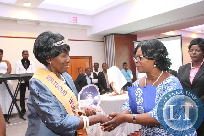 First Lady Esther Lungu has conferred the 2015 Virtuous Women Award on her honour the Vice-President of the Republic of Zambia , Mama Inonge Wina. This was during the Generation Impact Foundation Trust Virtuous Women Awards ceremony at Pamodzi Hotel in Lusaka on April 11,2015 -Pictures by THOMAS NSAMA