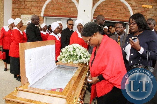 First Lady Esther Lungu pays her last respects to late Rev Violet Sampa Bredt during the funeral service at St Pauls UCZ Church in Lusaka on April 10,2015 -Picture by THOMAS NSAMA