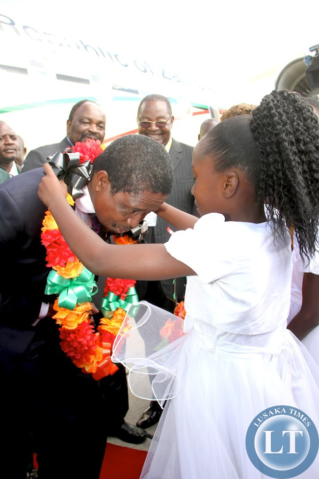 President Edgar Lungu being decorated on arrival at Harare International Airport for SADC Summit on April 28,2015 -Picture by THOMAS NSAMS