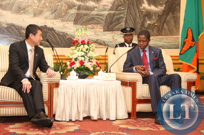 President Lungu during a meeting with Huawei Senior Vice-President Dafeng Li at Shenzhen Wuzhou Guest House in China on April 1,2015 -Picture by THOMAS NSAMA