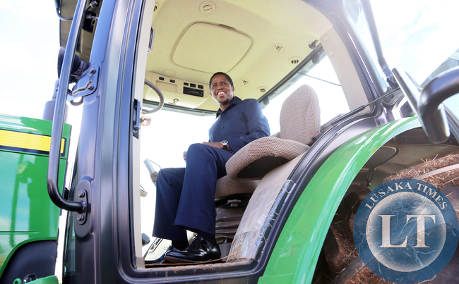 President Edgar Chagwa Lungu gets on the Tractor in Chisamba during the Agritech Expo Zambia 2015 on Saturday, April 18, 2015. PICTURE BY EDDIE MWANALEZA/STATE HOUSE ©2015.